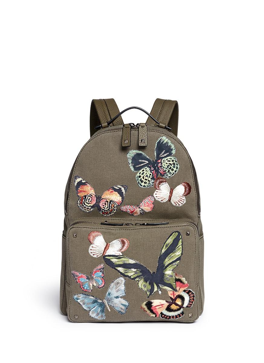 蝴蝶刺绣帆布双肩背包图片
