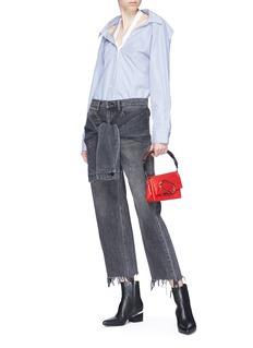 ALEXANDER WANG  衣袖式系带须边水洗露踝牛仔裤
