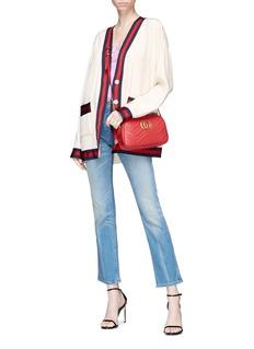 GUCCI 品牌名称印章微喇叭露踝牛仔裤