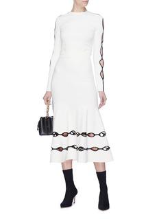 Alexander McQueen 双重镂空挖剪设计半身裙
