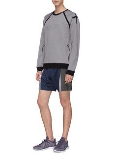 ISAORA Shadow反光细节拼色运动短裤