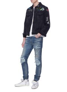 AMIRI MX1褶裥补丁破洞水洗修身牛仔裤