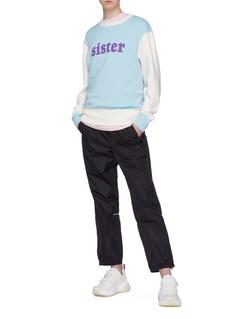 ACNE STUDIOS 条纹点缀表情徽章尼龙长裤