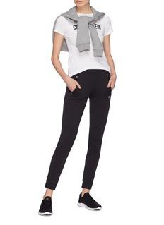 Calvin Klein Performance 品牌标志徽章修身弹力休闲裤