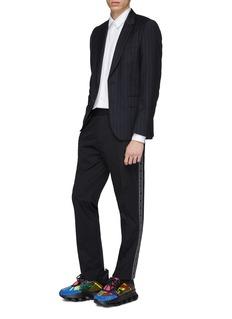 Versace 品牌名称条状布饰长裤