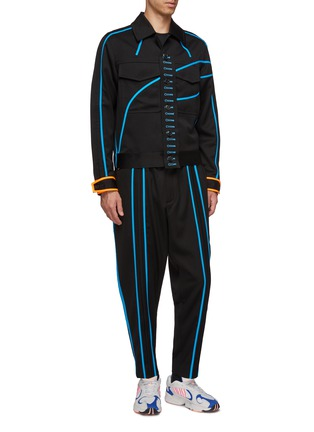 模特儿示范图 - 点击放大 - LI-NING x PRONOUNCE - 钮扣布饰拼色条纹口袋羊毛夹克