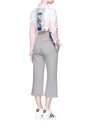 模特儿示范图 - 点击放大 - NICOPANDA - 胶印图案镂空短款牛仔夹克